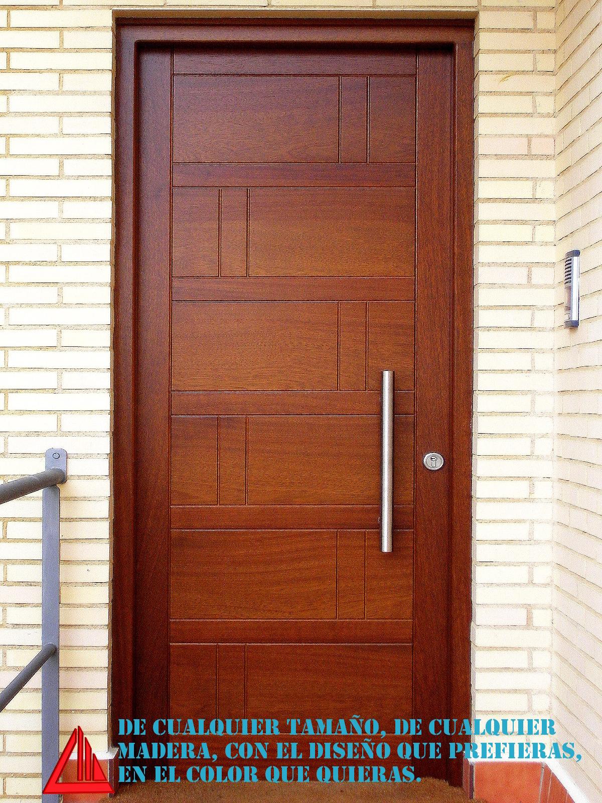 puerta de exterior de madera maciza fabricada por Carpintería Mena.